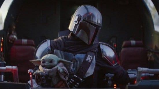 grogu and din djarin in razor crest cockpit