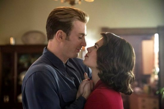 Hayley Atwell as Peggy Carter and Chris Evans as Steve Rogers aka Captain America kiss