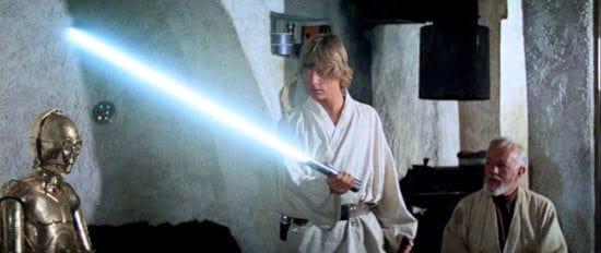 luke skywalker with anakin's lightsaber in a new hope