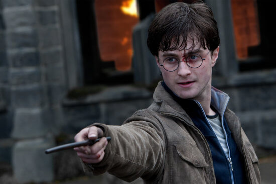Harry Potter holding the wand