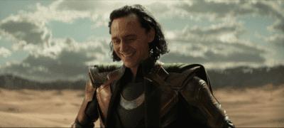 Tom Hiddleston as Loki laughing in the desert