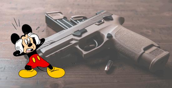 mickey looks startled at stock gun photo guns at disney world
