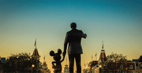 walt and mickey partners statue looking into sunset guns confiscated header