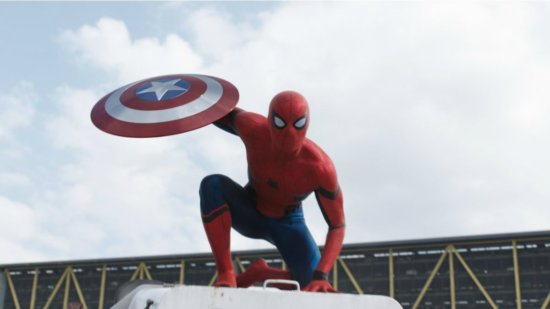 Tom Holland as Spider-Man holding Captain America's shield