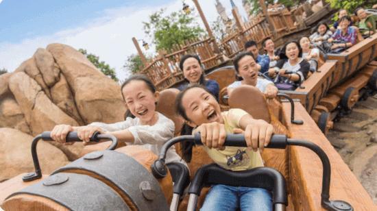 family riding seven dwarfs mine train in Shanghai Disney