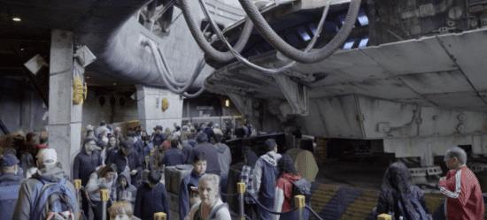 crowd by millennium falcon at galaxy's edge