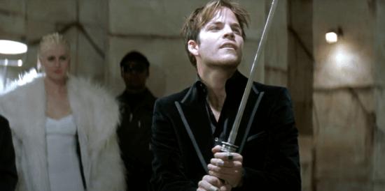Stephen Dorff as Deacon Frost holding a sword