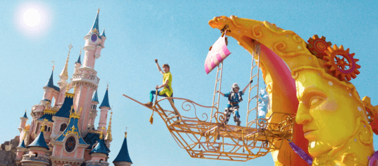 Peter Pan on a float in front of Sleeping Beauty Castle