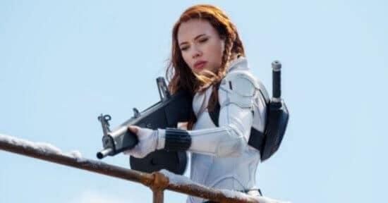 black widow holding rifle