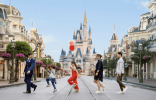 family in front of cinderella castle on VIP tour disney world