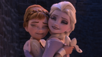 anna (left) and elsa (right) hugging in frozen 2