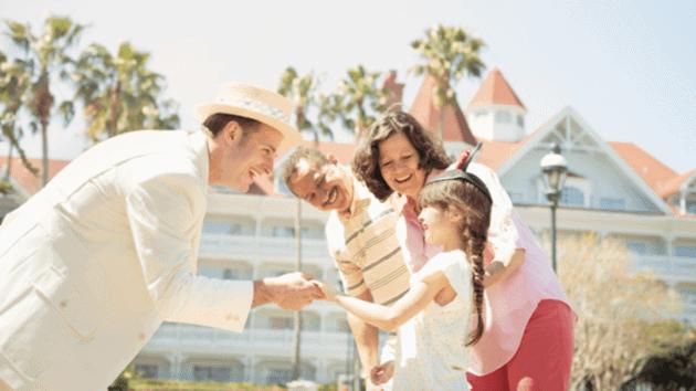 disney vacation club members greeting grand floridian cast member