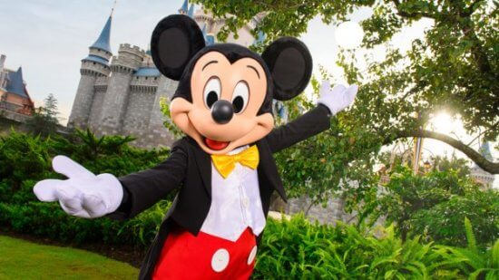 mickey mouse in front of cinderella castle