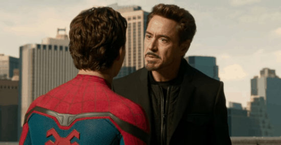 robert downey jr as Tony Stark aka iron man with tom holland as peter parker aka spider-man in homecoming
