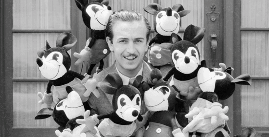 Young Walt Disney with Mickey Mouse plushes