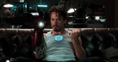 Robert Downey Jr as Iron Man fixing his suit