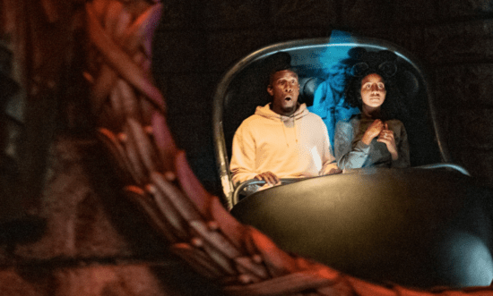 Guests riding Haunted Mansion