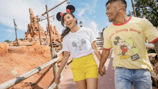 couple wearing disney world 50th merchandise