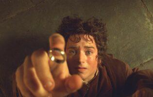 elijah wood catching the ring as frodo baggins