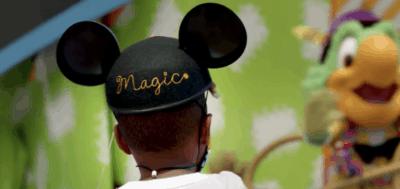 little boy wearing mickey ear hat
