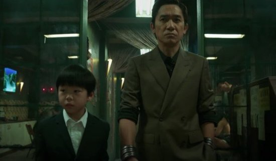 Tony Leung as Wenu AKA Mandarin with young shang-chi in Marvel's Shang-Chi and the Legend of the Ten Rings