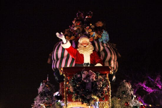a christmas fantasy parade at disneyland