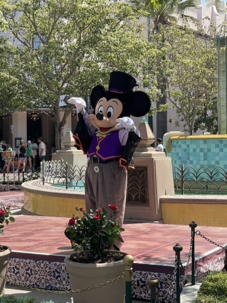 mickey mouse in costume on buena vista street