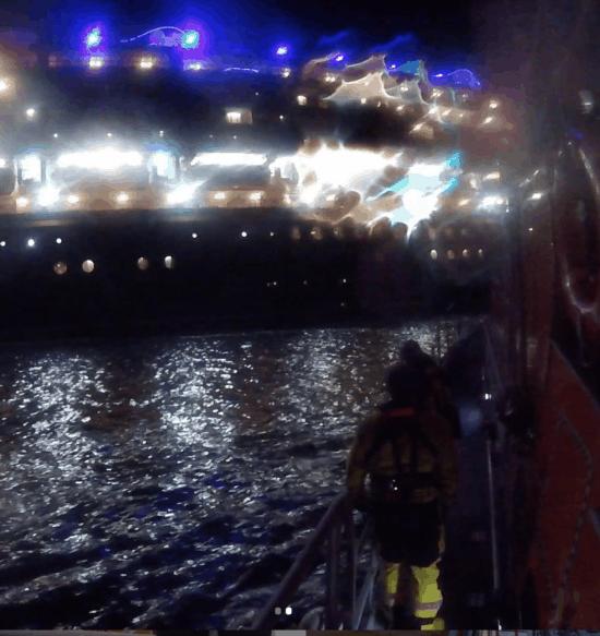Lifeboat approaching Disney Magic