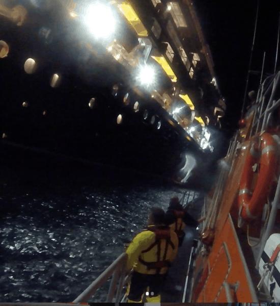 lifeboats approaching disney magic