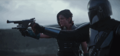 Cara Dune and Din Djarin holding blasters