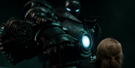Obadiah Stane in suit looking down on Pepper Potts