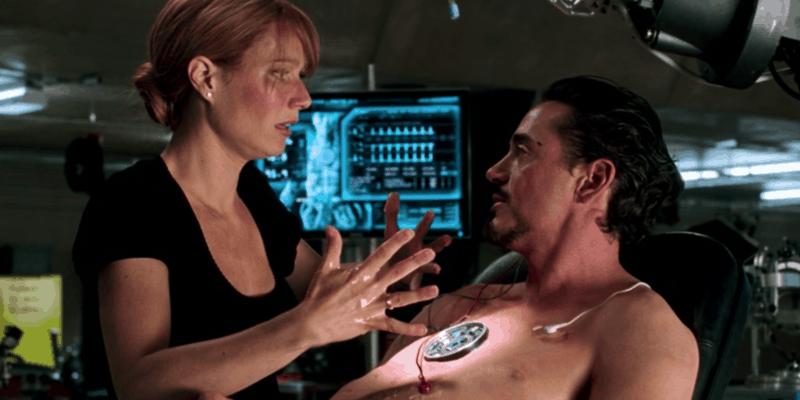 Pepper Potts helping Tony Stark