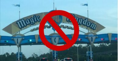 Magic Kingdom Park Sign with stop sign in front