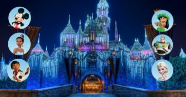 disneyland castle with christmas lights (background) six disney characters (foreground)