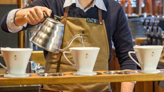 barista pouring starbucks reserve coffee