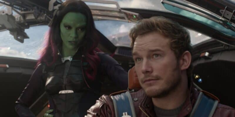 Zoe Saldana as Gamora (left) looking at Chris Pratt's Peter Quill/Star-Lord in the cockpit of the Milano