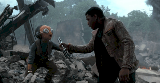 Maz Kanata handing Finn Luke Skywalker's lightsaber in the ruins of her establishment