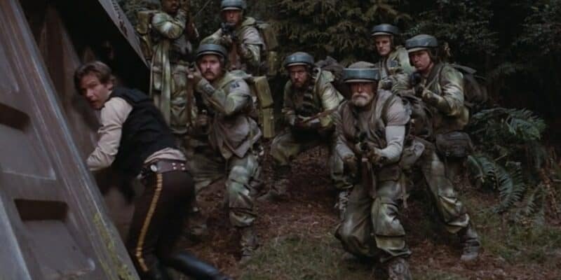 Group of Rebels surrounding Han Solo on Endor